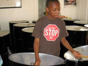 child playing steelpan