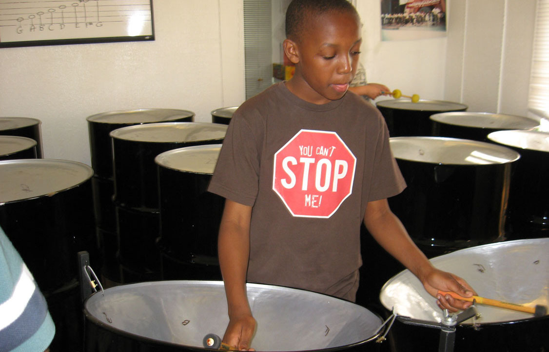 child playing steelpan